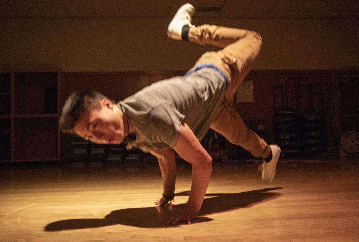 Dance major, Jeremy Xiong break-dances in a dance studio at American River College during the Dance Production: Studio and Stage class, on Feb. 6, 2019. He describes himself as a b-boy. (Photo by Ashley Hayes-Stone)