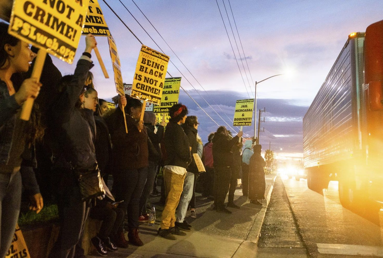 Demonstrators gather on the corner of Florin Road and 29th Street to protest the decision by the Sacramento County District Attorney's Office to not press charges against the two police officers who shot and killed Stephon Clark last year. (Photo by Patrick Hyun Wilson)
