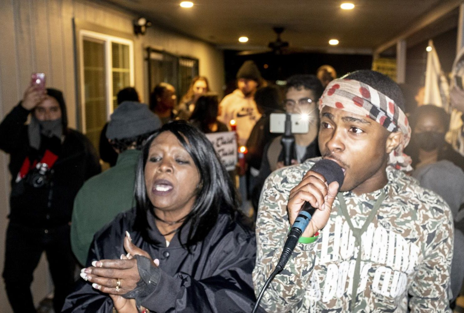 Stevante Clark, brother of Stephon Clark, speaks to a crowd of demonstrators in their grandmother's backyard on March 6, 2019, where last year two Sacramento Police Department officers shot and killed Stephon Clark. (Photo by Patrick Hyun Wilson)