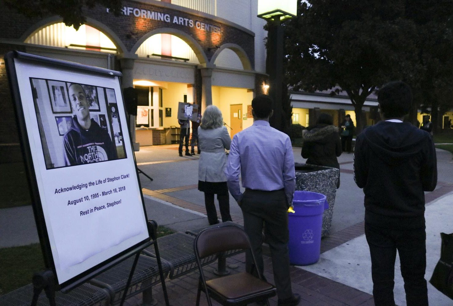 Attendees of the vigil watch the organizers address the crowd in front of the Performing Arts Center at Sacramento City College on March 7, 2019. The group spoke about the importance of education and its role in activism. (Photo by Hannah Yates)