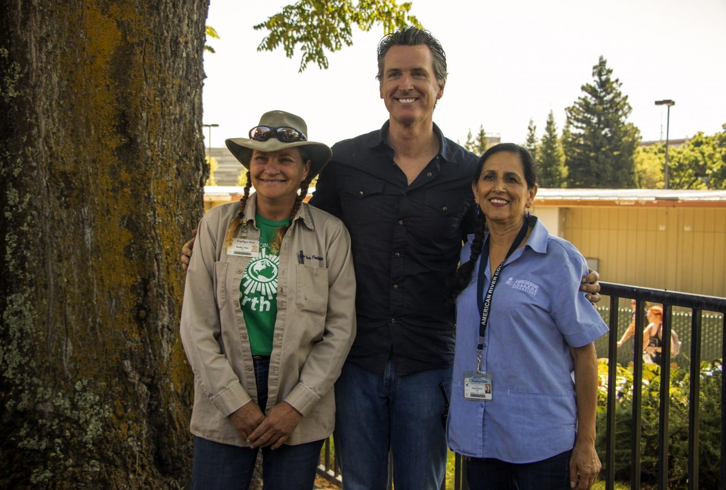 Governor Gavin Christopher Newsom poses with Brenda Baker (left) and Maria Arambula (right) after job shadowing them during International Workers' Day at American River College on May 1, 2019. (Photo by Ashley Hayes-Stone) Download Permiss