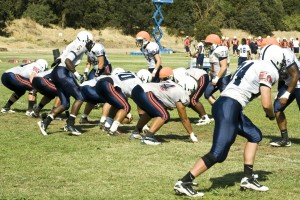 The ARC football running back squad practices on the American River College field. Photo by Bryce Fraser