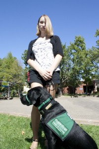 Jennie Nickel walks Clement, a puppy in training for a guide dog program, through the ARC campus. (Photo by Bryce Fraser)
