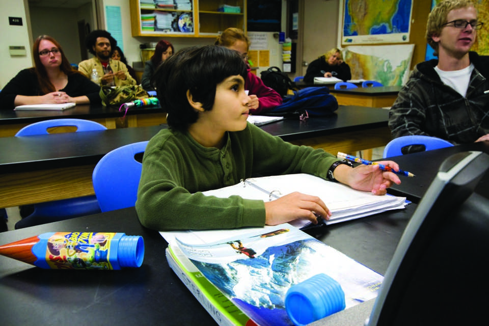 Eight-year-old Tanishq Abraham takes notes in his physical geology class taught by Professor Stephen Sterling on Oct. 5, 2011. (Photo by Bryce Fraser)