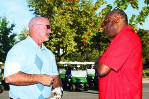 ARC football coach Jerry Haflich, left, and Dusty Baker, right, talking at the second annual Dusty Baker Golf Tournament at Turkey Creek Golf Course in Lincoln, Calif. (Photo by Bryce Fraser)
