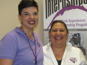 Connie Ayala, Program Coordinator Cooperative Work Experience, and Kendalyne Murti greet  visitors at the Career Center Open House on Feb  23.