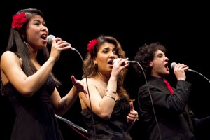 From left: Jessica Dacpano, Maryam Mirbagheri and Jonathan Blum of the advanced American River College Vocal Jazz Ensemble performing at a concert in the American River College campus theater on March 14. (Photo by Bryce Fraser)