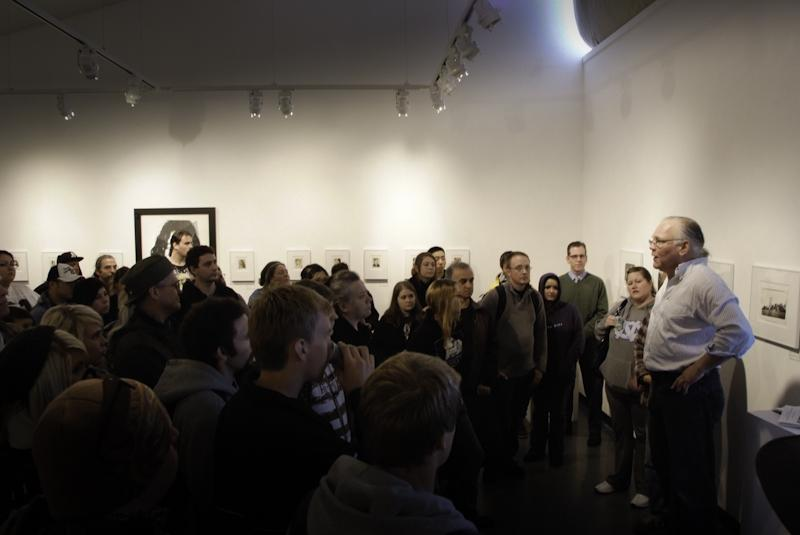 ARC+art+history+professor+Ken+Magri+explains+how+special+the+March+13+Andy+Warhol+exhibit+is+to+a+packed+room.