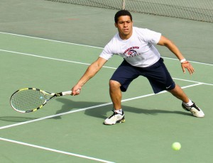 Sophomore tennis player Pscar Figueroa has come from being relatively unknown to the sport of tennis to now helping to lead the ARC men's tennis team to a 9-1 conference record. (Photo by Stephanie Lee)