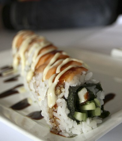 A Philly Roll that is served at Azukar Sushi in Natomas. The roll comes with eel, cream cheese, cucumber, smoked salmon, tabiko and a miso sauce. (Photo by Daniel Romandia)