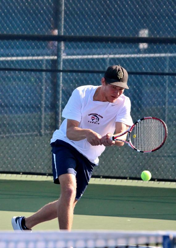 Simba Barratti stretches out to return a serve in his singles match versus Modesto Junior College player Xavier Lopez Feb. 12. Barratti went on to win the match (6-0, 6-0). (Photo by Emily K. Rabasto)