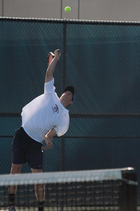 Patrick Johnson won 6-0, 6-2 in his Singles match on Saturday, Feb. 02 against Reedley College. (Photo by Emily K. Rabasto)