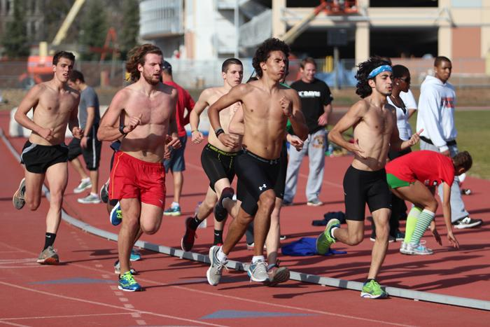 ARC's Men's Long Distance Track Team practices by running in small groups around the track on Monday, Feb. 04. (Photo by Emily K. Rabasto)