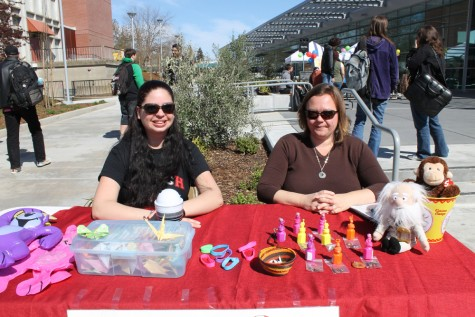Two participants running a booth during Club Day.