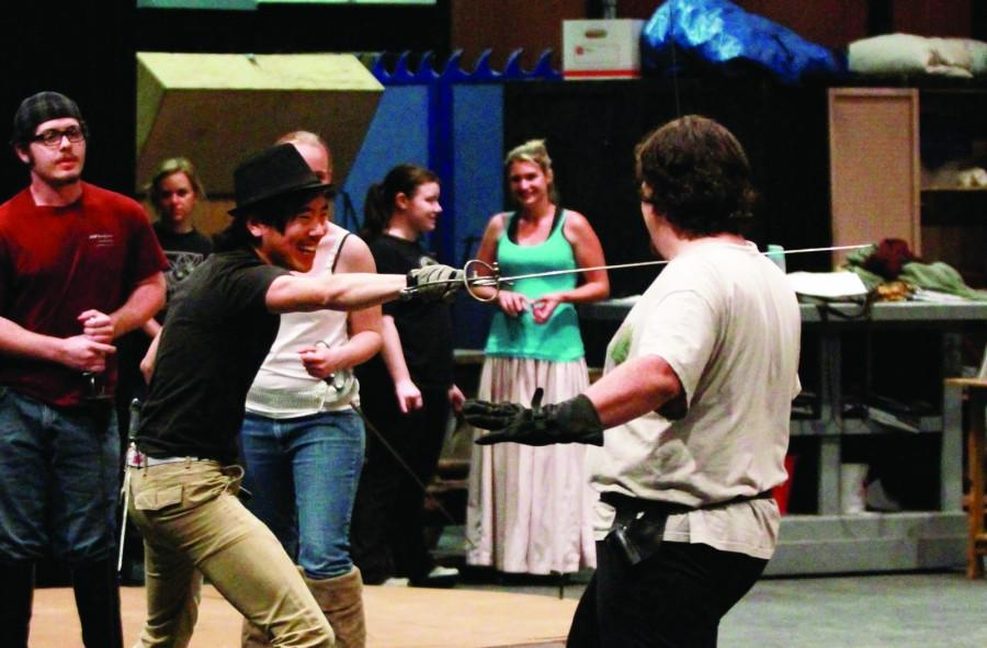 Matthew Johnston and Aaron Bayless practice dueling with fencing swords during a fight scene rehearsal for the ARC theater production of The Three Musketeers which runs from April 26 to May 5. (Photo by Emily K. Rabasto)