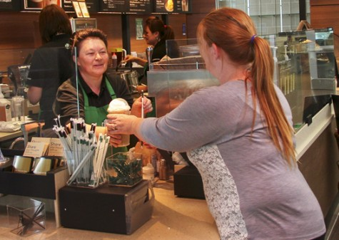Barista serves up coffee and compliments