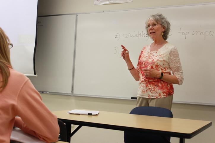 Professor Nancy Miller explains an exercise where she asks students to arrange cards with words on them in order of most important to least important to them in her class Psychology 390 or Psychology of Death and Dying, on Tuesday, April 29, 2013.