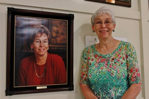 American River College interim president Marie Smith poses next to her previous portrait, taken in 1995, when she first took the position of president almost 18 years ago. (Photo by Emily K. Rabasto)