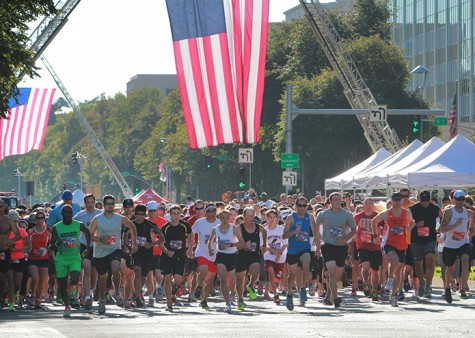 At exactly 9:11 a.m. after the national anthem and a moment of silence, 1,200 runners began the race on Sunday, Sept. 8. (Photo by Emily K. Rabasto)
