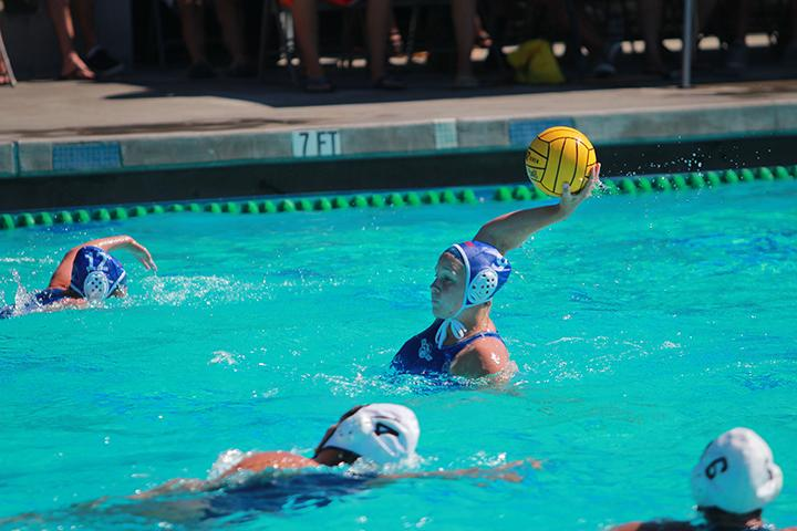Carly Ashen passes the ball to her teammate in a Women's Water Polo match against Orange Coast College on Friday, Sept. 6, 2013. ARC quickly gained the lead over Orange Coast College in the first half, ending the half with a 5-3 lead. ARC ended the match with a win. The final score was 8-7. Photo by Emily K. Rabasto