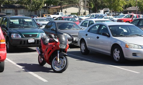 A motorcycle parked between cars on August 29, 2013. According to Los Rios Police Department policy,