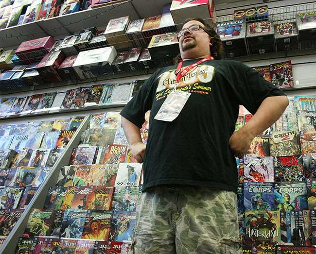 Comic books have seen an upswing in popularity, largely in part to their silver screen counterparts. A1 Comics employee Jared Rudy stands by some of his favorite comics. (Photo by Alisha Kirby)