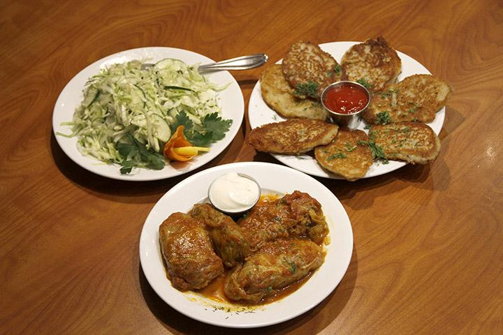 Firebird+Russian+Restaurant+and+Gallery+serves+traditional+Eastern+and+Central+European+fare+such+as+%28clockwise+from+left%29+cucumber+and+cabbage+salad%2C+mashed-potato+latkes+and+golubtsi%2C+cabbage+rolls+stuffed+with+beef+and+rice.