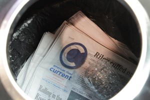 "Dozens of copies of ""The Current"" sit in a trashcan after ASB representative Jorge Riley threw them away."