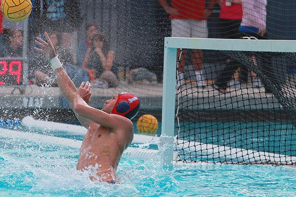 American River College men's water polo goal keeper Sam Anderson blocks a shot during the Big 8 Conference in November, 2013. Photo by Emily K. Rabasto