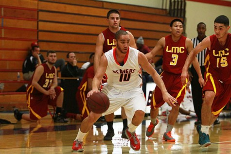 Freshman Isaac Woods outruns a group of Los Medanos College players during their game on Nov. 7. (Photo by Emily K. Rabasto)