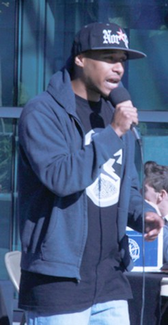 """American River College students look on as fellow ARC scholar Tim Defazio performs his song """"Christ Over Money"""" at Club Day. With Thanksgiving right around the corner, he performs the song with the purpose of giving God honor and glory. He is thankful to be blessed with the gift to make such music so he wanted to share his message with the American River community."""
