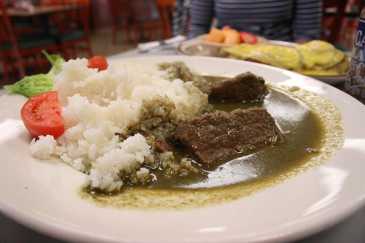 Seco de carne, which translates to cilantro beef stew, is an authentic Peruvian dish of tender beef drenched in a green sauce of cilantro, spinach, garlic and onions. (Photo by Alisha Kirby)
