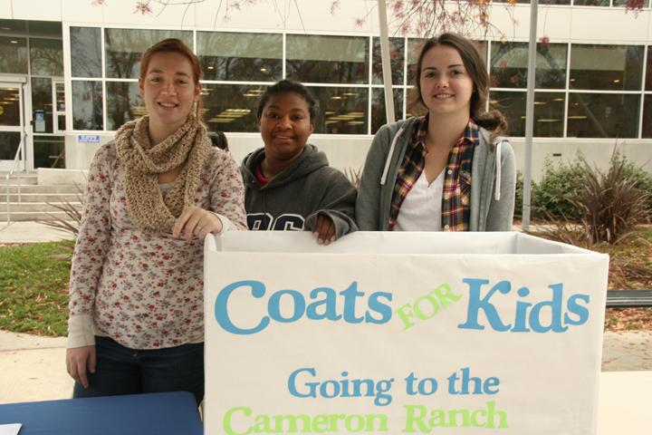 Taylor Zirbel, Faydra Acker and Kayla Reeser, all early education majors, collect coats and canned goods on behalf of the ARC teaching club and Student California Teacher's Association for Cameron Ranch Elementary School. They will be outside the ARC library all this week from 12 a.m.-4 p.m.