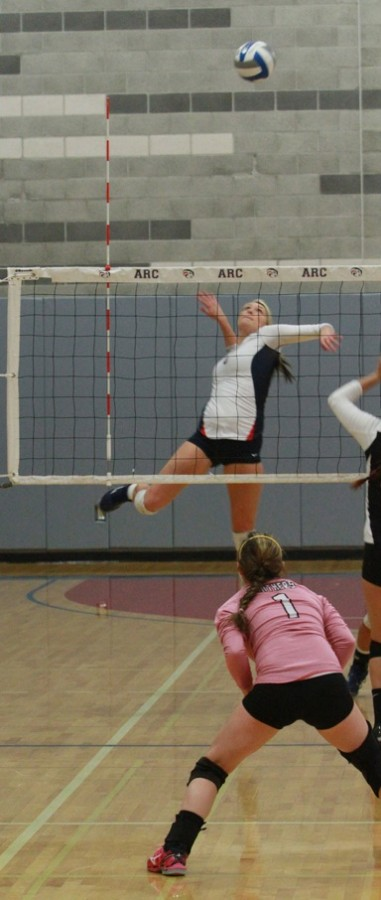 Sophomore middle hitter Nicole Hareland goes for a kill during the first round playoff match against Hartnell College.