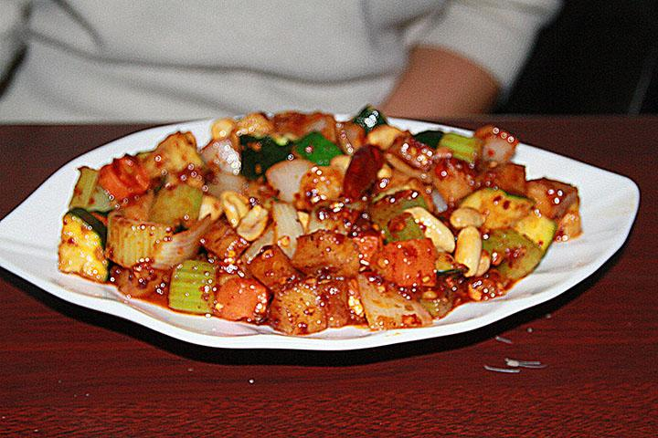 The Tasty Kung Pao Vegeken, a vegetarian version of Chinese restaurant staple Kung Pao Chicken, is served with mixed cubed vegetables, peanuts and wheat-based meat replacement in a spicy sauce.