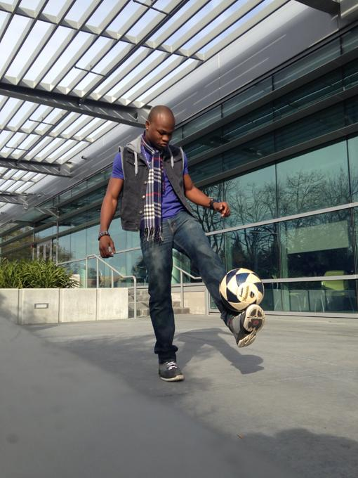 Bila Kintaudi, 22, juggles with a soccer ball on campus. Kintaudi plays his favorite sport during winter break. (Photo by Sam Urrea)
