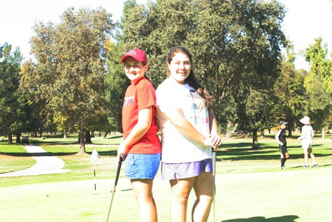 Freshman Gabby Rosales and Sophomore Megan Santo Domingo practicing at Anil Hoffman Golf Course on Oct. 23. Photo by Shedric Allen