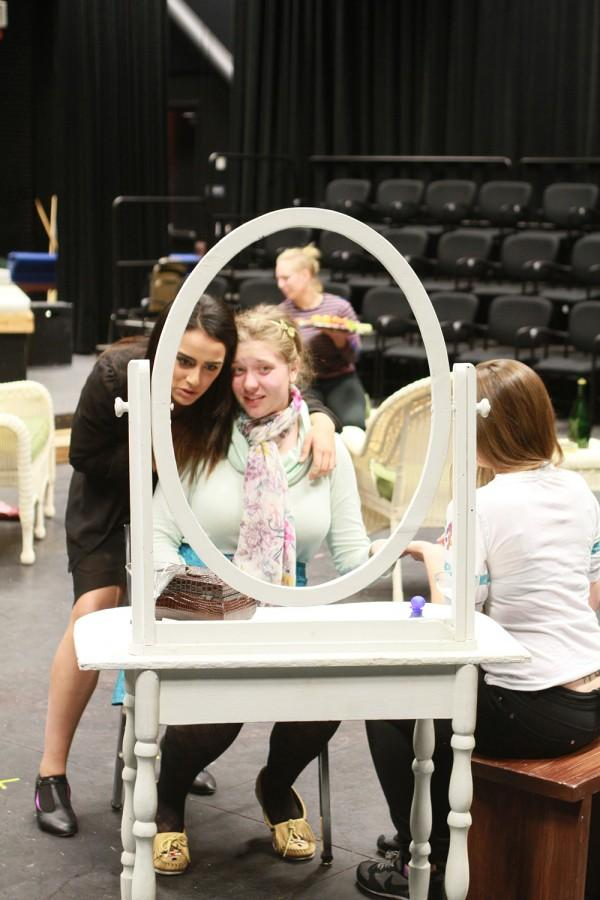 Cast members Mondis Vakili, left, and Ashley Rose, rehearse a scene from the second act of Five Women. (Photo by Kameron Schmid)