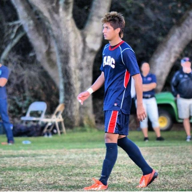 ARC+soccer+player+kicks+it+family+style