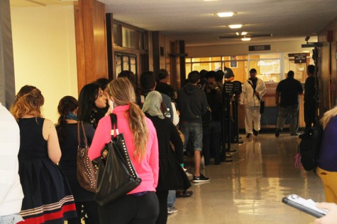 Students wait in line to pay for classes and parking permits on the first day of classes. The line wrapped through the administration building. The best way to avoid the lines is to pay your fees early. (Photo by Brandon Nelson)