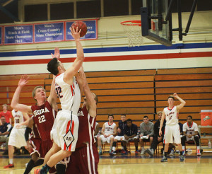 Freshmen forward Nazarly Yakimchuk takes it to the hoop in Friday's game against the Sierra College Wolverines.