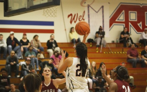 Sophomore guard Gloria Garcia goes for a layup in Friday nights game against the Sierra College Wolverines, the proceeds of which went to the Marc Zhuchenko memorial fund.