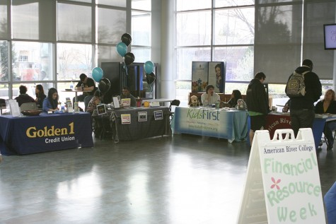 Students receive help from  several booths inside the Student Center during Financial Resource Week.