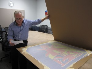 "Art history professor Ken Magri opens the two silkscreen copies of Warhol's ""Hans Christian Andersons""."