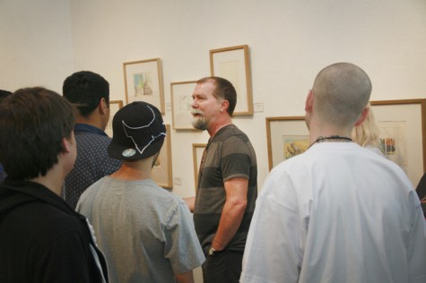 Craig Smith explains to students how he uses his drawings for future painting.