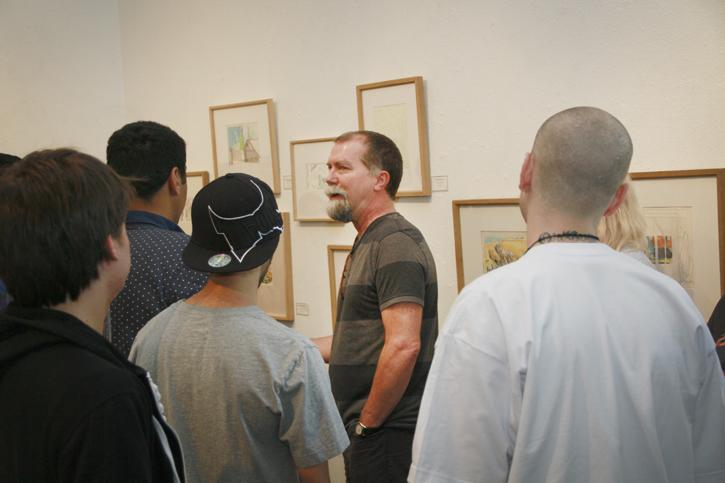 Craig+Smith+explains+to+students+how+he+uses+his+drawings+for+future+painting.