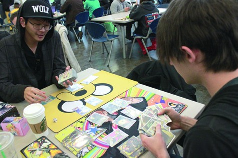Josep Scalice, left, and Phillip Wingett play 'Weiss Schwarz,' a Japanese card game which has become increasingly popular in the United States. By Emily K. Rabasto