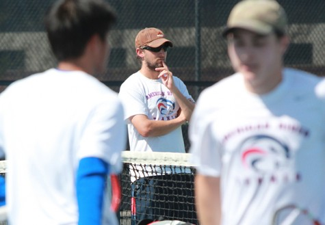 Coach Bobak Jabery-Madison watches his team play on Mar. 21. Jabery Madison won his second Coach of the Year award, and five of the men's tennis players made the Big-8 All Conference team. Photo by Emily K. Rabasto
