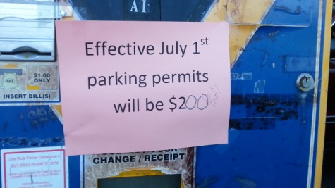 """""""Oh, look, a political statement,"""" said LRPD officer Kathy Church, in reference to a written comment on one of the many pay stations throughout the ARC campus she reset this morning as a result of the district-wide daily parking pass fee increase effective today. (Photo by Brooke Purves)"""