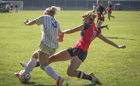 American River College freshman defender Whitney Pickard attempts to slip the ball away from San Joaquin Delta College forward Tiffany Souza in a match on Sept. 23. ARC and SJDC tied 1-1, continuing the women's undefeated-at-home streak. (Photo by Emily K. Rabasto)